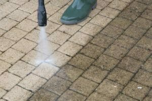 cleaning the concrete with power washer